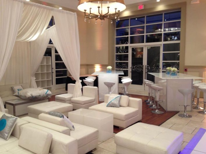 White-lounge-decor-with-community-tables-scoop-stools-and-privacy-booths