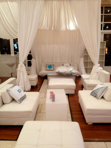 White-lounge-decor-with-custom-pillows-and-privacy-booths