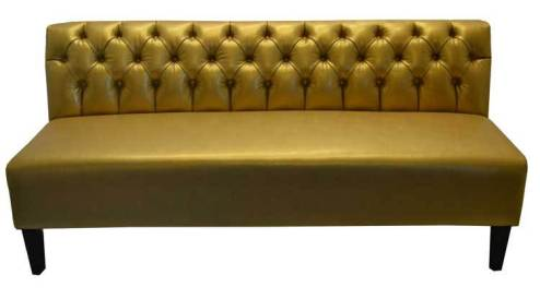 Gold couch with tufted back