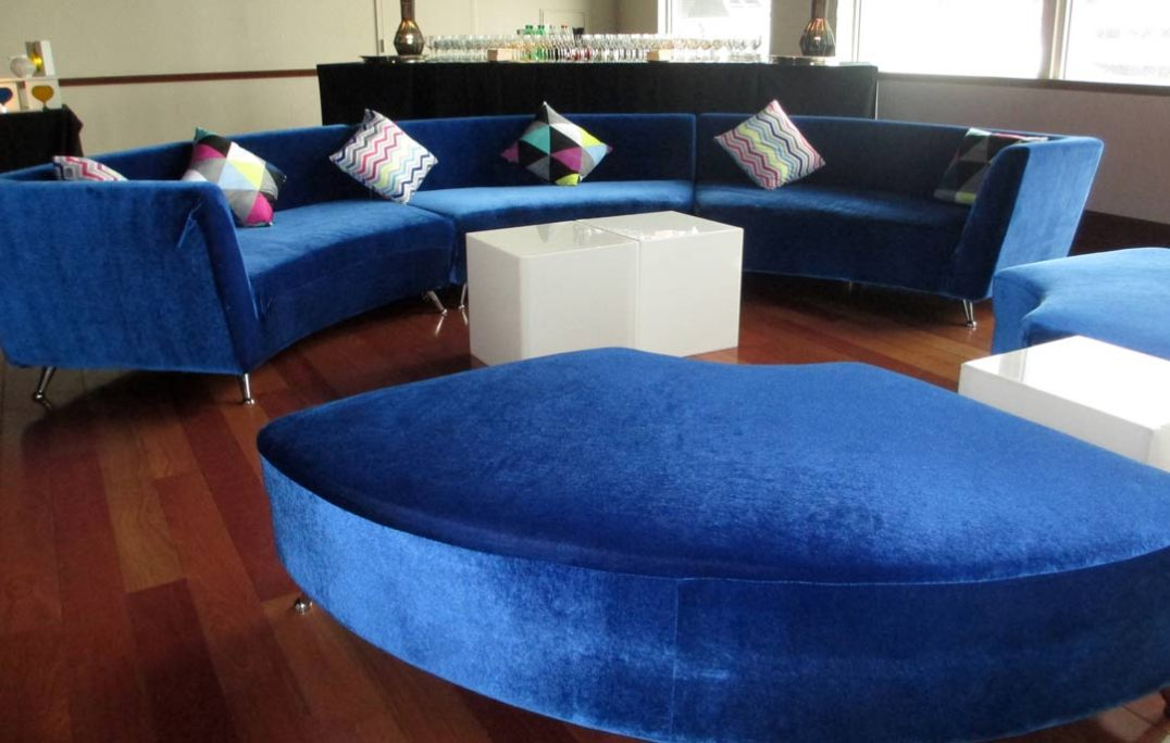 Sapphire-lounge-furniture-with-curved-couch-and-ottomans