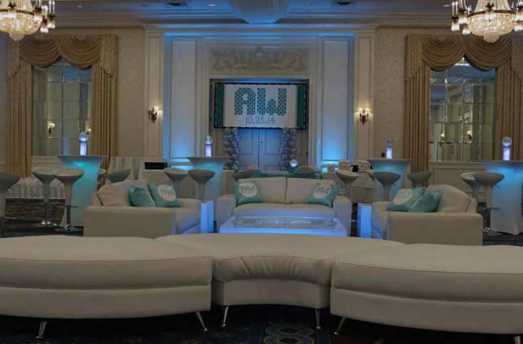 White-Lounge-decor-with-half-moon-seating-illuminated-hi-boys