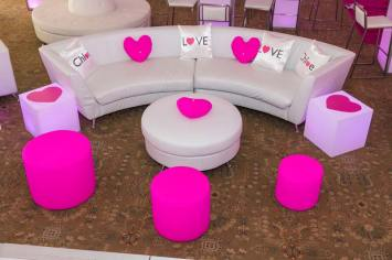 bat-mitzvah-white-curved-couch-with-heart-pillows-and-pink-ottomans