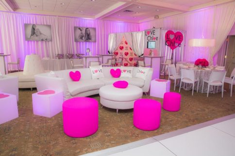 bat-mitzvah-white-furniture-pink-ottomans-heart-pillows-borne-couch-silver-entrance