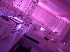 pink-mitzvah-lounge-decor-illuminated-tables-sparkle-beaded-curtain-illuminated-tables-and-sheer-pink-drapes