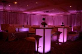 pink-mitzvah-pipe-and-drape-with-white-furniture-illuminated-hi-boys-and-scoop-seating