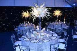 space theme bar mitzvah decor with silver linens, solar centerpieces