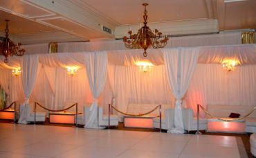 white-and-gold-mitzvah-with-white-privacy-booths-and-chandeliers