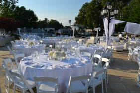 Country-Club-Event-Production-Tables-Chairs-Centerpieces-Palm-Props-and-Tablecloths