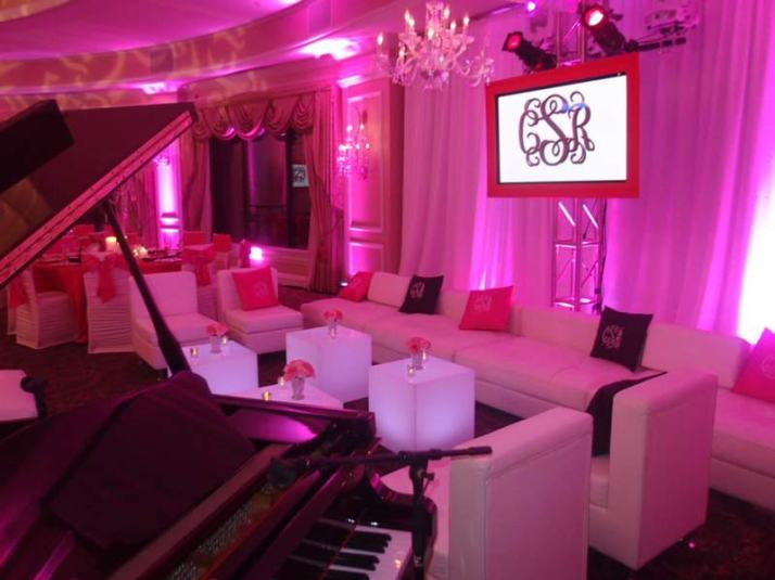 Sweet-16-Lounge-Decor-with-illuminated-cubes-chandeliers-video-screen-pipe-and-drape
