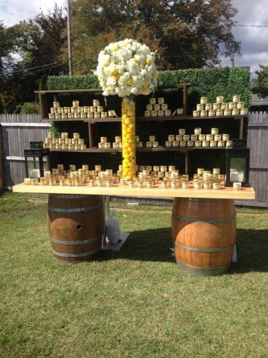Rustic-concession-stand-with-jams-and-floral-centerpiece-for-country-wedding