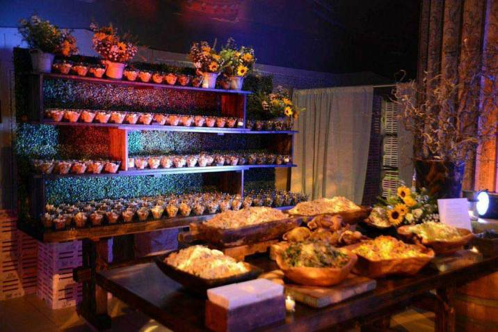 Rustic-shelves-and-table-decorated-with-country-bowls-and-jars