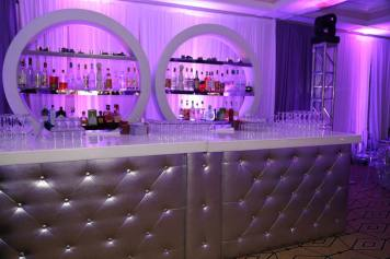 Silver-tufted-bar-with-round-shelves