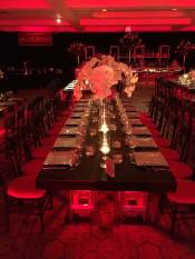 leather-covered-tables-with-bamboo-chairs-and-floating-candles