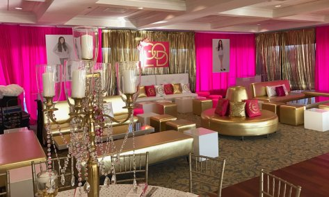 Gold-metallic-event-furniture-with-custom-pillows-and-metallic-pipe-and-drape