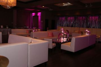 White-lounge-decor-with-custom-centerpieces-mylar-pipe-and-drape