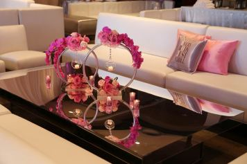 white-lounge-decor-pink-custom-pillows-mirrored-table-pink-rose-and-silver-candle-holders