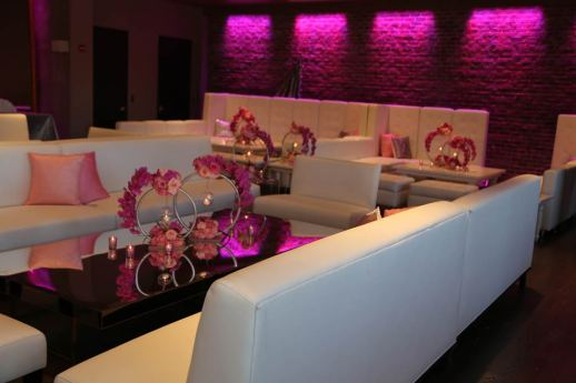 white-lounge-decor-with-pink-centerpieces