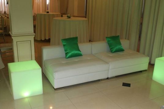 white-low-back-couches-green-custom-pillows-illuminant-cubes