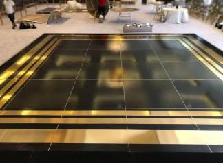 Portable-black-dance-floor-with-gold-design-border