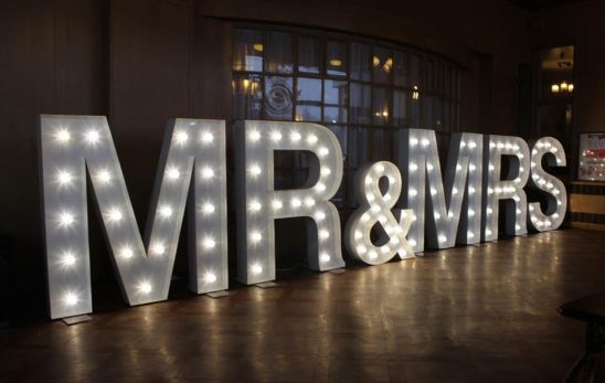 Mr & Mrs Marquee Letters in a room where a wedding party is being held