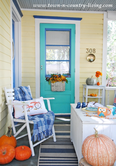 Fall Front Porch with Pumpkins and Flowers