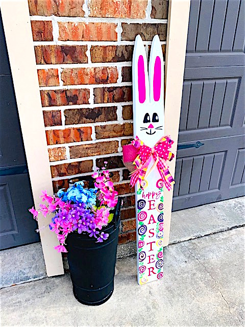 Hoppy Easter Porch Leaner with Swirl Flowers outside garage door.