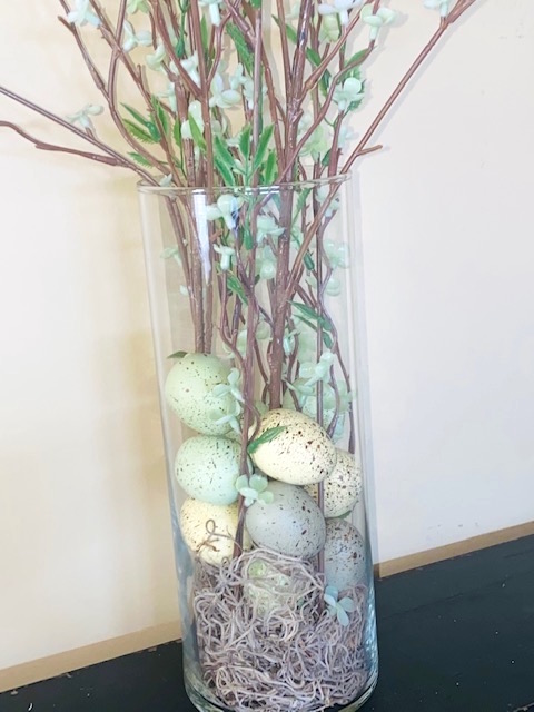 Spring Arrangement in Clear Glass Vase with Moss and Bird's Eggs.