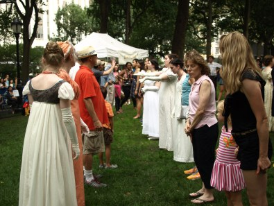 Costumed volunteers dance on the lawn (Photo by Maria Rocha-Buschel)
