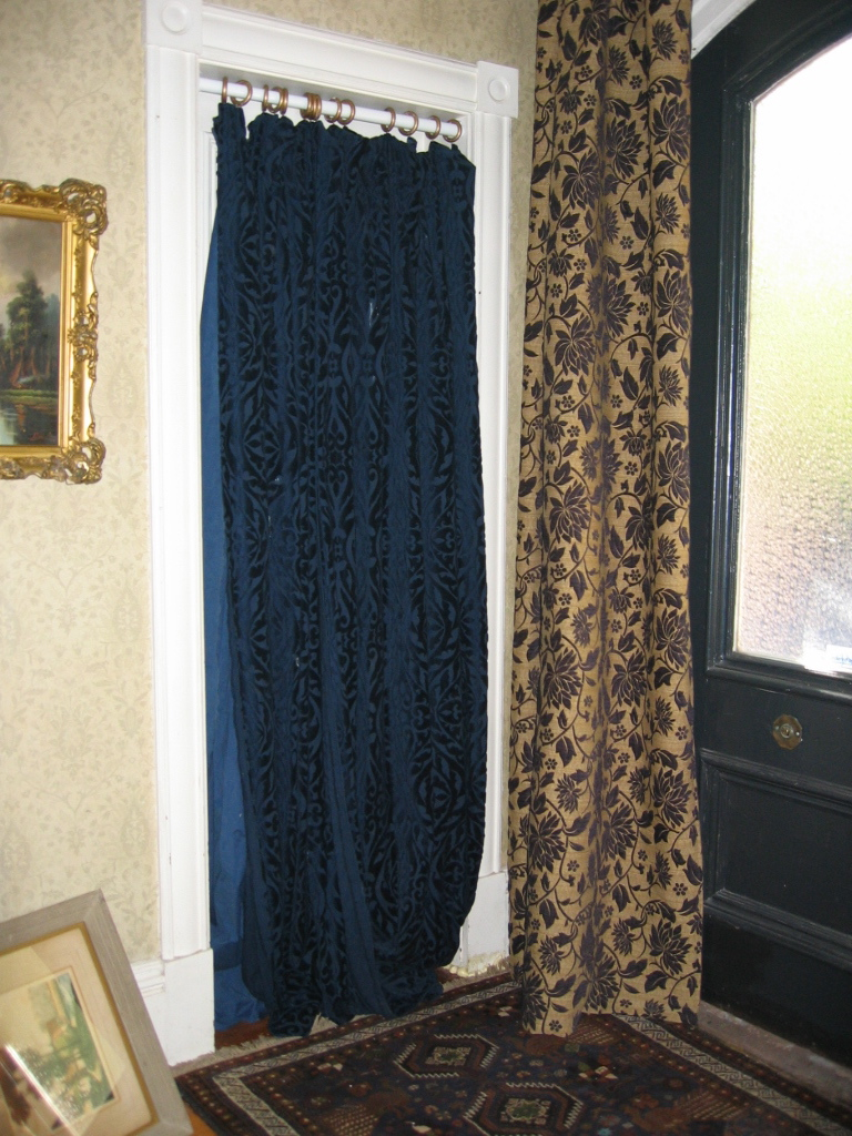Putting Up Curtains To Hide A False Door Townhouse