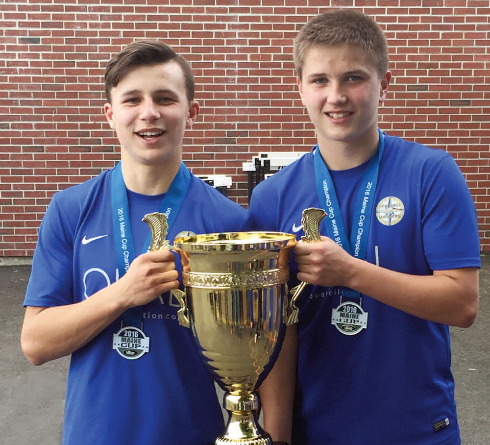Michael Wildes, left, and Jake Warn, both of Winslow, are starters on the U16 Seacoast Mariners premier soccer team. On June 12 they defeated GPS Phoenix, 7-0, to win the State Cup for the third consecutive year.                         Photo courtesy of Central Maine Photography