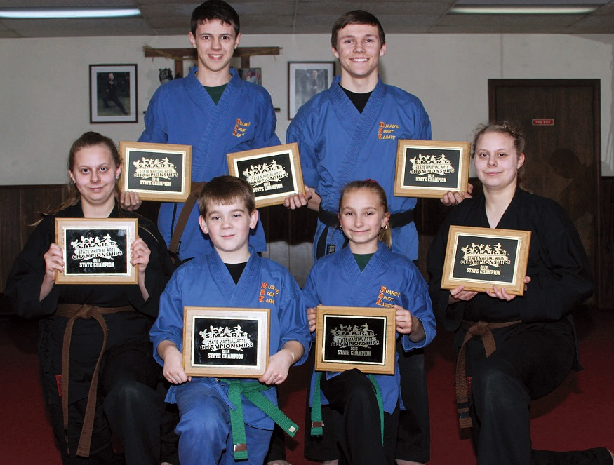 Above, members of Huard's Sport Karate team captured 2016 state championship titles on December 3 at the SMART Rating Championships. Front row, from left to right, Theresa Lamanteer, Austin Lizotte, Abby Dudley and Traci Lamanteer. Back, Tyler Bard and Kayle Anderson. In photo below, Mikayla Achorn, right, also a member of the team is pictured with Sensei Mark Huard. She captured titles in both forms and fighting. Photos courtesy of Mark Huard, owner Central Maine Photography