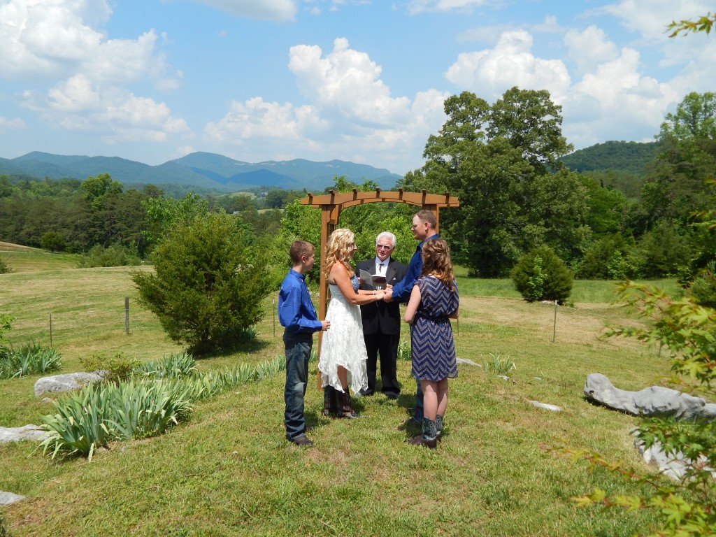 This couple used our cedar arbor at the Rock Garden for their wedding site.