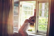 Apartment dweller - Girl leaning on window