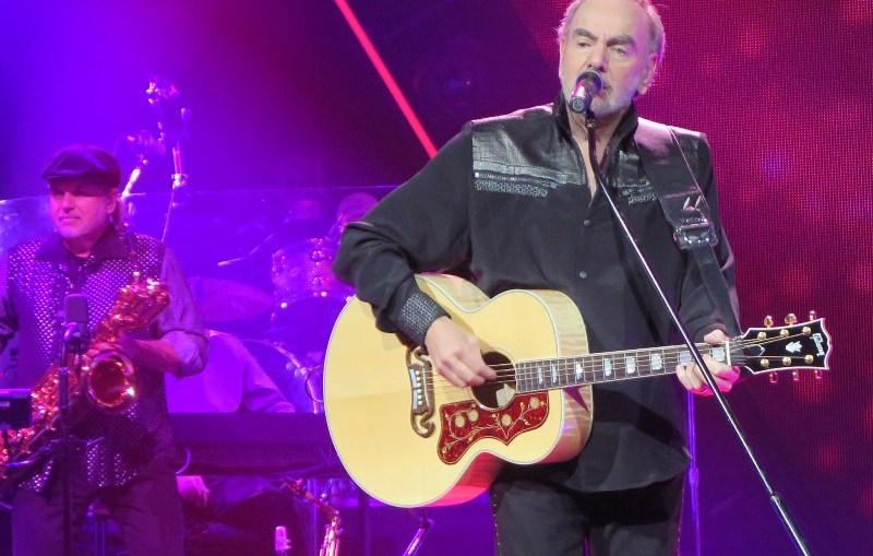 Neil Diamond - Rock superstar Neil Diamond on stage playing one of his famous melodies. Photo taken by Peter Hutchins