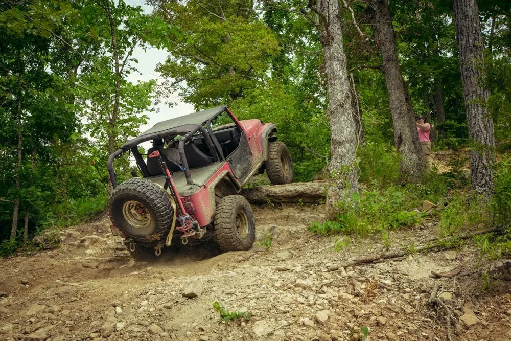 A Jeep making quick work of a large rock
