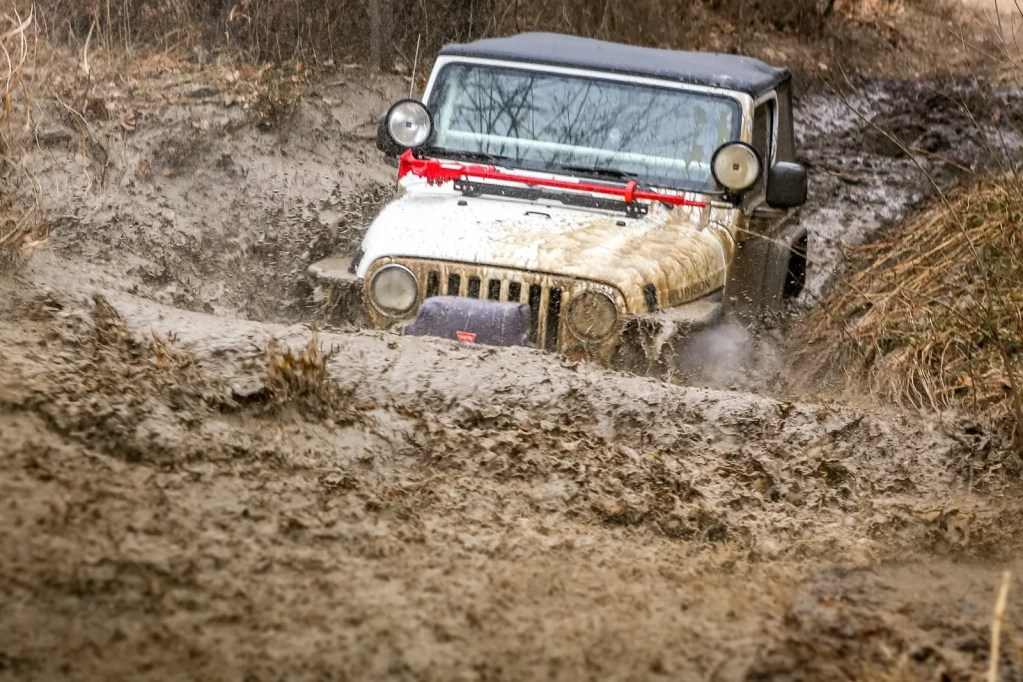 Jeep playing in mud pit at Disney OK