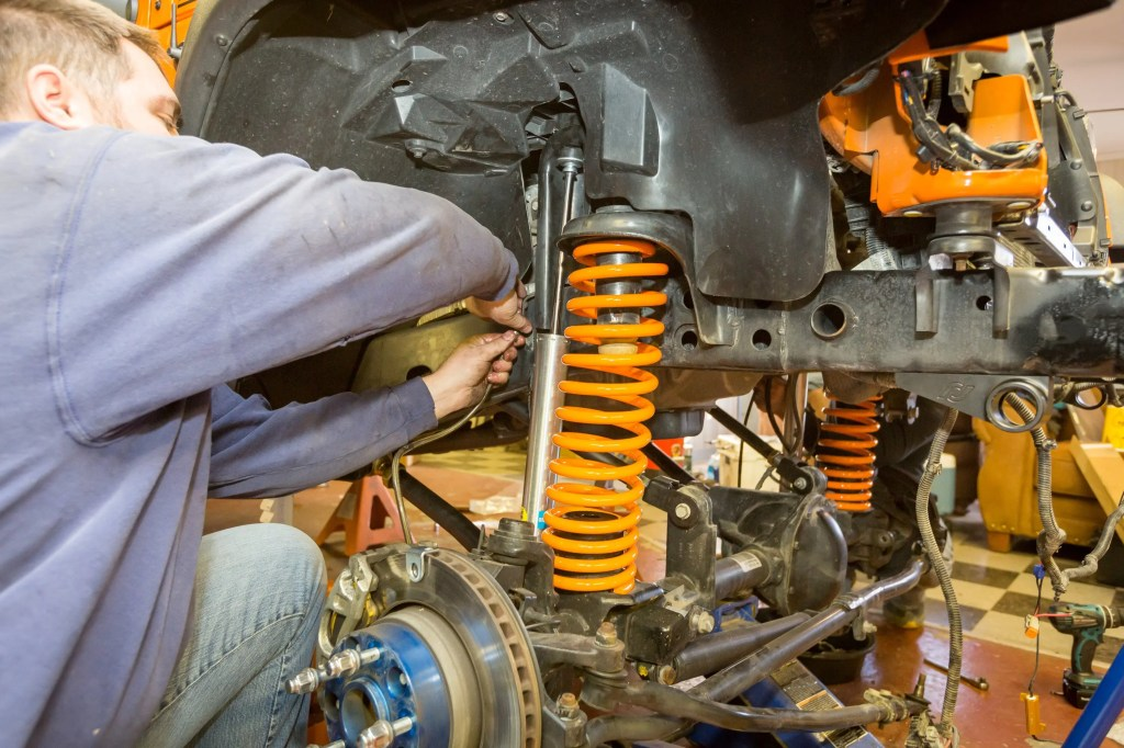 Hooking up brake lines during the Currie Enterprises suspension system install