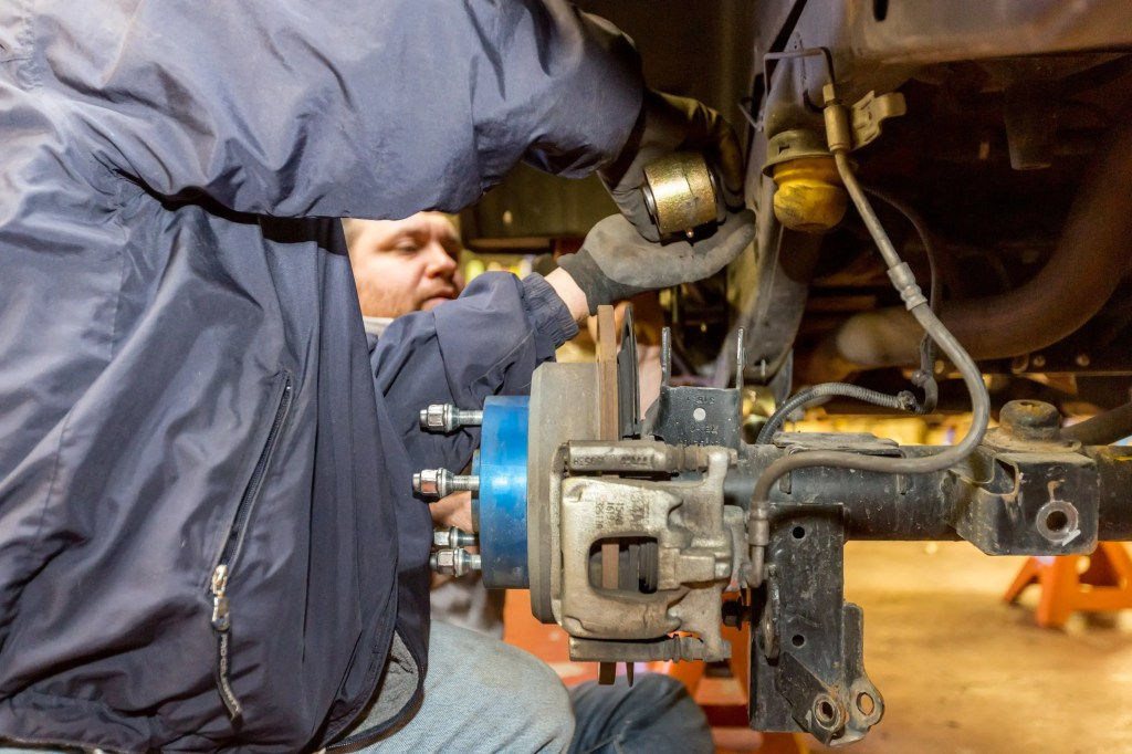 Currie Enterprises Suspension System control arm being installed