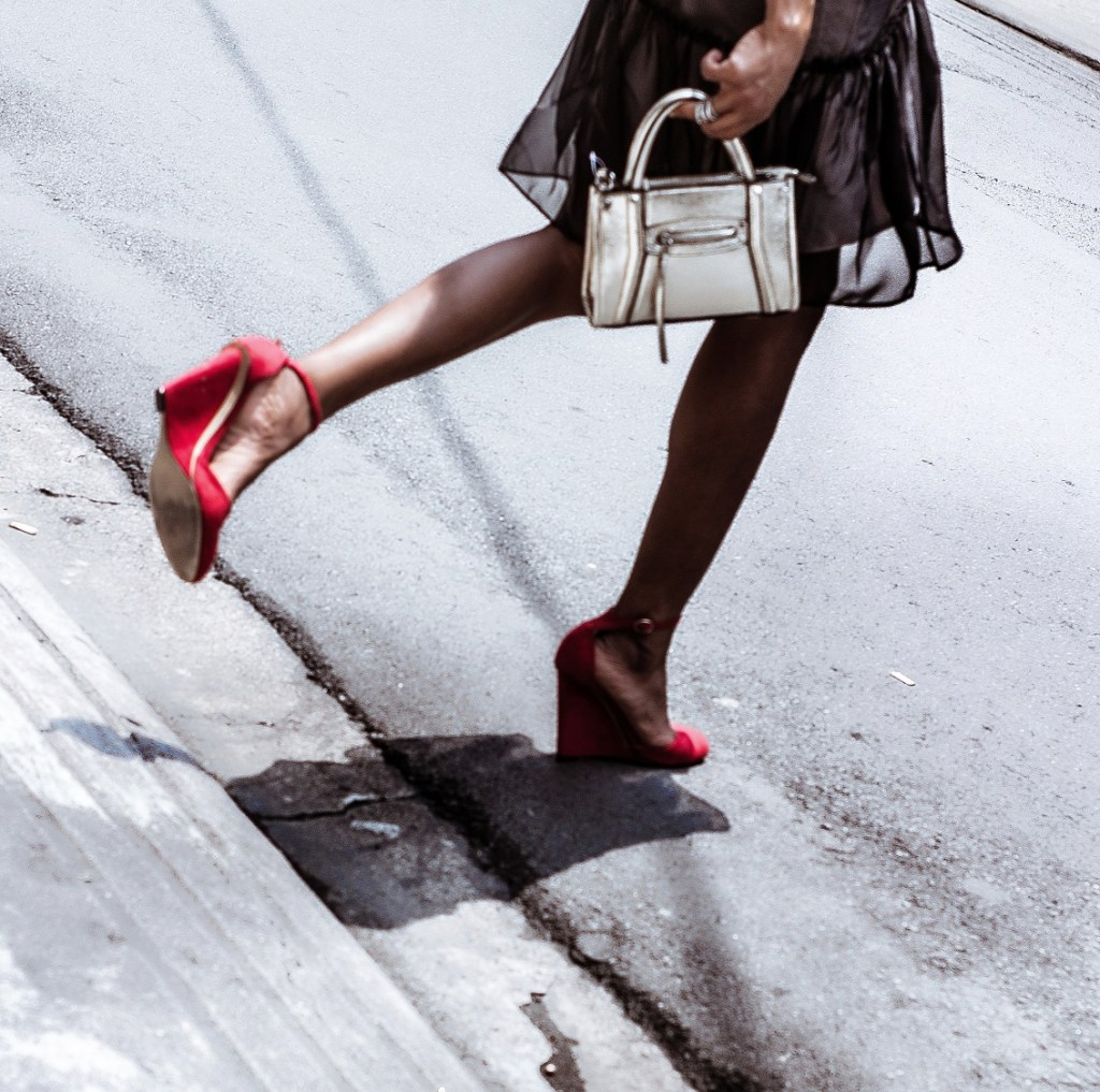 gold purse red shoe street style