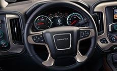 Picture showing luxurious heated steering wheel in the 2017 GMC Sierra 1500 Denali light-duty pickup truck.