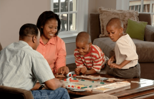 Mom and Dad drop by a session of kids games to see that everything is going smoothly.