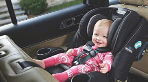 Baby in the beast convertible car seat. This seat will grow with the child as it converts into a seat for an older child.