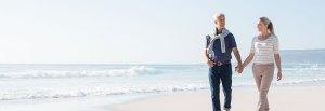 Husband and Wife walk the beach