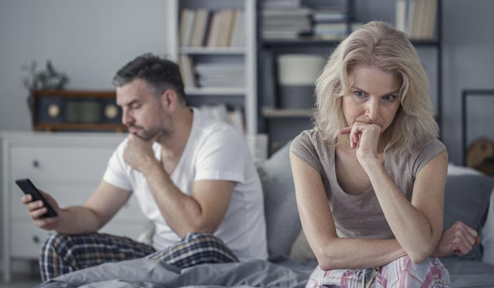 Wife is upset while husband on his phone