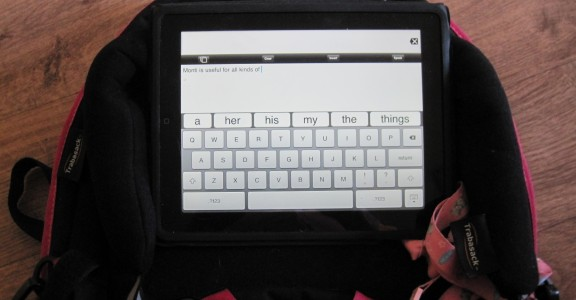 Image of an iPad Communication Aid being used on the tray of the Trabasack Curve