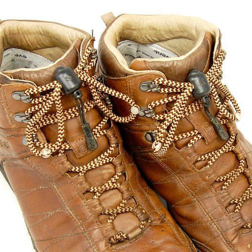 Photograph of brown hiking boots fastened with beige and brown Greeper Hikers laces