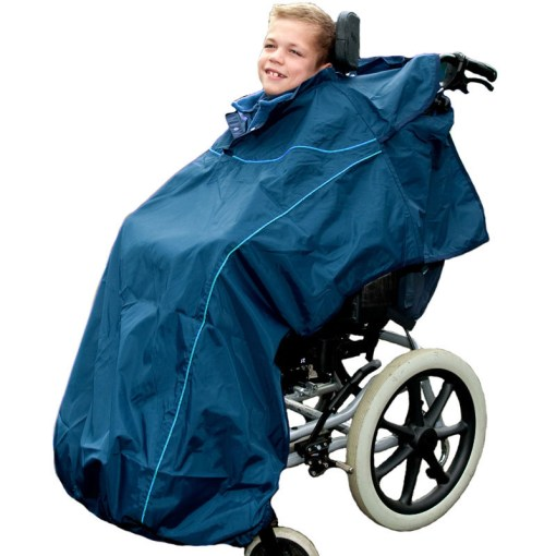 Image shows a photograph of a boy smiling towards the camera, sat in a wheelchair wearing a Seenin navy blue total waterproof cover