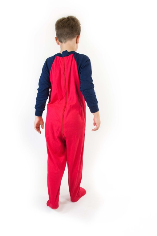 Image shows a photograph of a boy facing away from the camera, to illustrate the back detail of the Seenin sleepsuit in navy and red