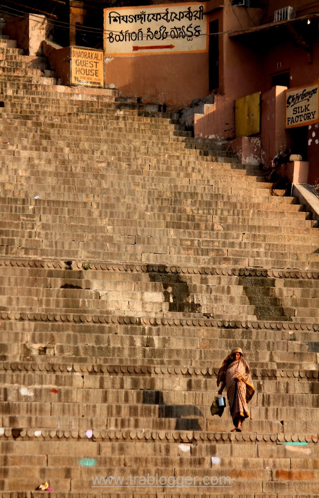 Woman Climbing Down the ghats
