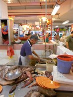 Cleaning fish in Singapore market